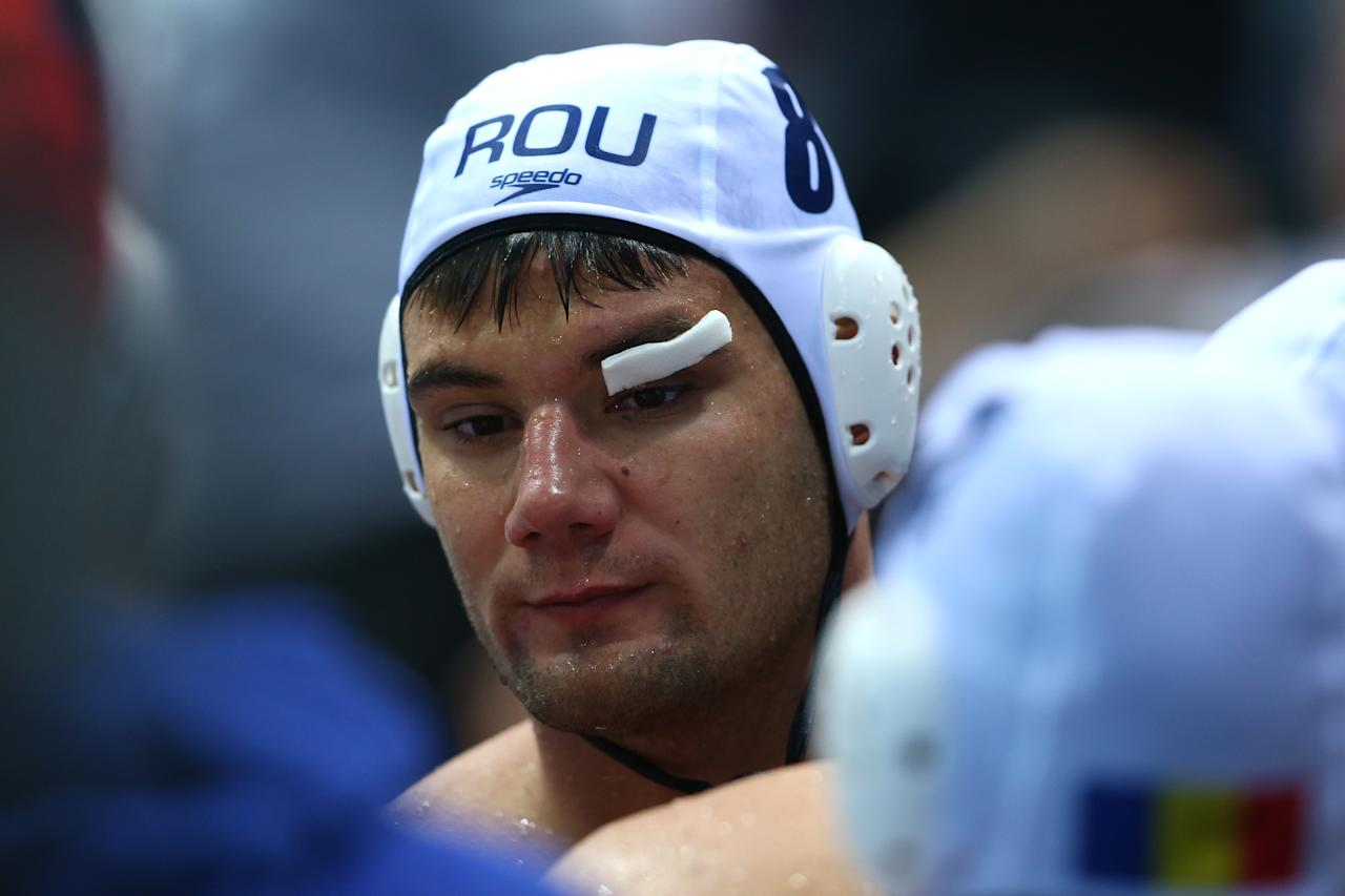 LONDON, ENGLAND - JULY 29:  Mihnea Chioveanu of Romania looks on in the Men's Water Polo Preliminary Round Group B match between Great Britain and Romania on Day 2 of the London 2012 Olympic Games at Water Polo Arena on July 29, 2012 in London, England.  (Photo by Alexander Hassenstein/Getty Images)
