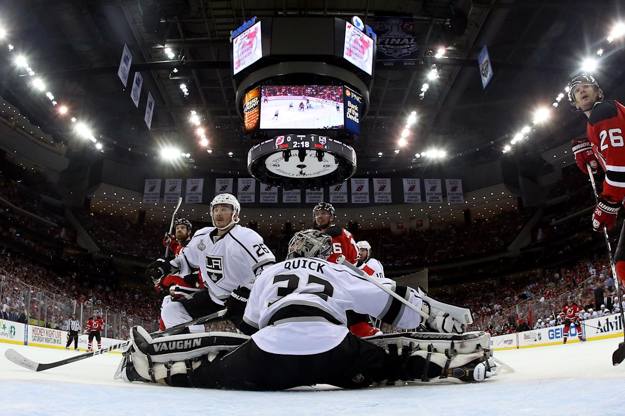 NEWARK, NJ - MAY 30: Jonathan Quick #32 of the Los Angeles Kings tends goal in the first period as Slava Voynov #26 of the Los Angeles Kings, Jacob Josefson #16 and Patrik Elias #26 of the New Jersey Devils look on during Game One of the 2012 NHL Stanley Cup Final at the Prudential Center on May 30, 2012 in Newark, New Jersey.  (Photo by Bruce Bennett/Getty Images)