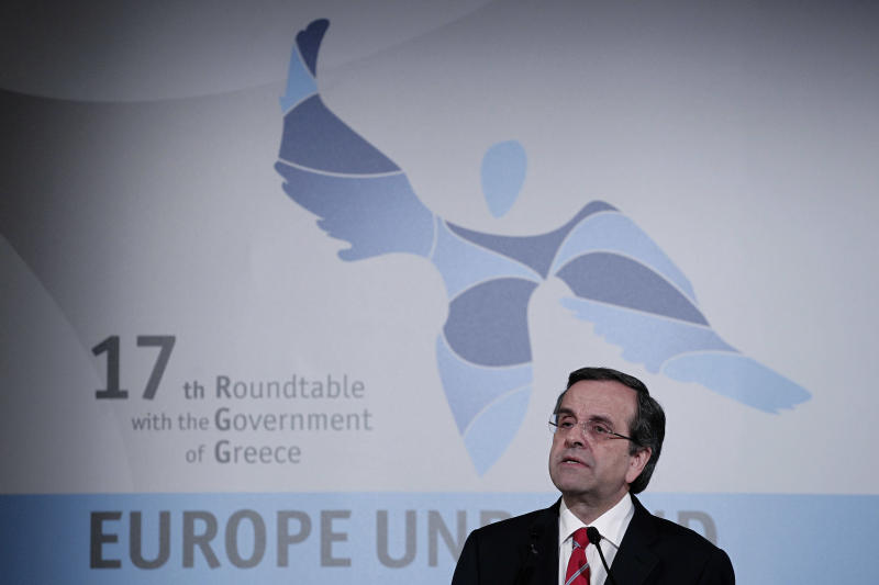 Greece sticks with austerity, seeks debt relief