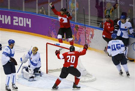 Canada's Doughty celebrates after scoring the game winning overtime goal against Finland's goalie Rask, during overtime period in their men's preliminary round ice hockey game at the Sochi 2014 Winter Olympics