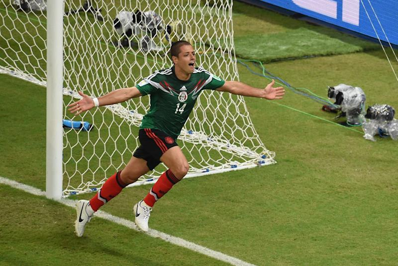 Mexico's forward Javier Hernandez reacts after scoring his team's third goal during a World Cup match between Croatia and Mexico in Recife on June 23, 2014
