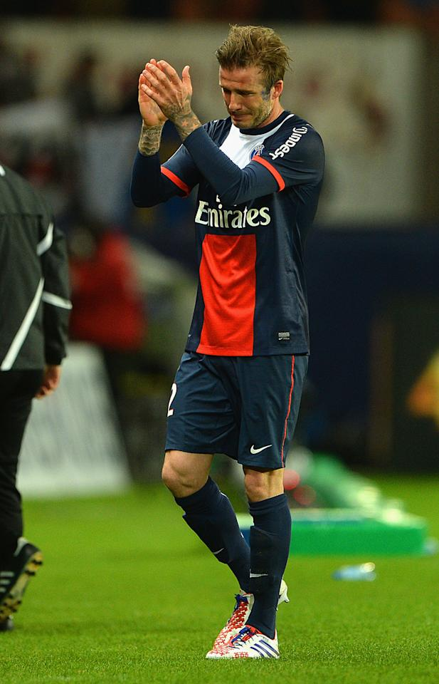 PARIS, FRANCE - MAY 18: David Beckham of PSG reacts as he is substituted during the Ligue 1 match between Paris Saint-Germain FC and Stade Brestois 29 at Parc des Princes on May 18, 2013 in Paris, France. (Photo by Michael Regan/Getty Images)