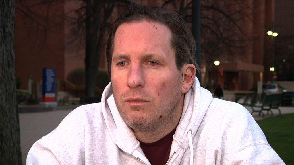 This image from video shows Boston Marathon bombing victim Kevin White during an interview with the Associated Press on Wednesday evening, April 17, 2013 soon after Kevin White was released from Boston Medical Center, where he was treated for injuries he suffered in Monday's blast. Kevin White had just left a restaurant with his parents when the first of two bombs that hit the Boston Marathon exploded about 10 feet away. The force of the blast, he said Wednesday, was so strong that it slammed them to the ground, breaking some of his mother's bones and tearing his father's right foot so badly surgeons had to amputate it. (AP Photo/Rodrique Ngow)