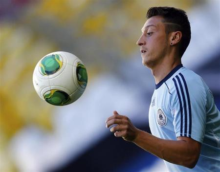 German national soccer team player Ozil plays during a training session in Munich