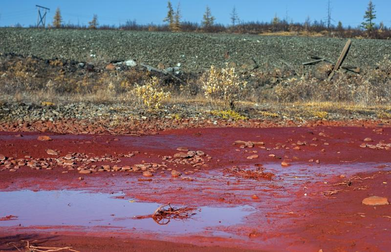 Russian metals company says river turned red by waste