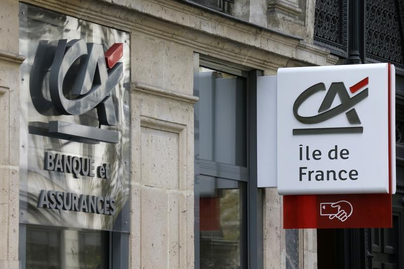 Logos are seen on a Credit Agricole branch in Paris