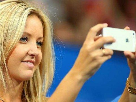 A girl is taking a photo with an iPhone