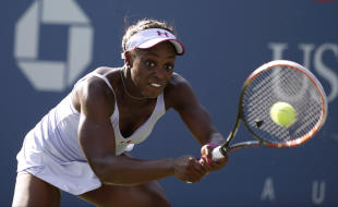 Sloane Stephens returns a shot against Annika Beck. (AP)