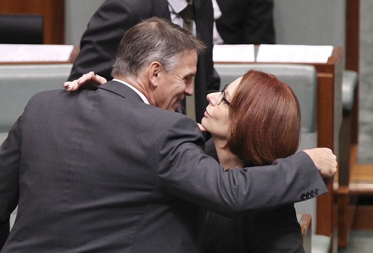 CANBERRA, AUSTRALIA - JUNE 27: Rob Oakeshott hugs Julia Gillard after delivering his valedictory speech in the House of Representatives on June 27, 2013 in Canberra, Australia. Kevin Rudd won an Australian Labor Party leadership ballot 57-45 last night, and will be sworn in this morning as Australian Prime Minister by Governor-General Quentin Bryce. Rudd was Prime Minister from 2007 to 2010 before he was dumped by his party for his deputy Julia Gillard. Gillard has announced that she will leave parliament and not contest her seat following her ballot loss. (Photo by Stefan Postles/Getty Images)