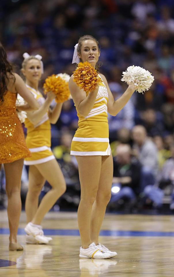Tennessee cheerleaders perform during the first half of an NCAA Midwest Regional semifinal college basketball tournament game against the Michigan Friday, March 28, 2014, in Indianapolis. (AP Photo/David J. Phillip)