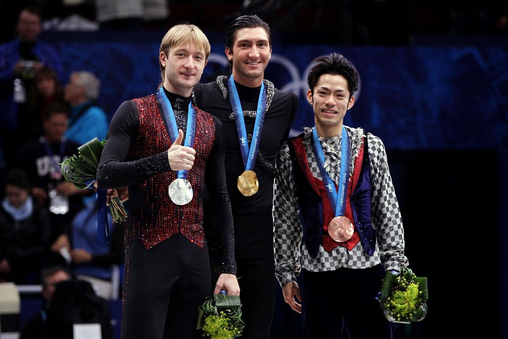 VANCOUVER, BC - FEBRUARY 18:  Gold medalist Evan Lysacek (C) of the United States poses with silver medalist Evgeni Plushenko (L) of Russia and bronze medalist Daisuke Takahashi of Japan in the men's figure skating free skating on day 7 of the Vancouver 2010 Winter Olympics at the Pacific Coliseum on February 18, 2010 in Vancouver, Canada.  (Photo by Matthew Stockman/Getty Images) *** Local Caption *** Evan Lysacek;Evgeni Plushenko;Daisuke Takahashi