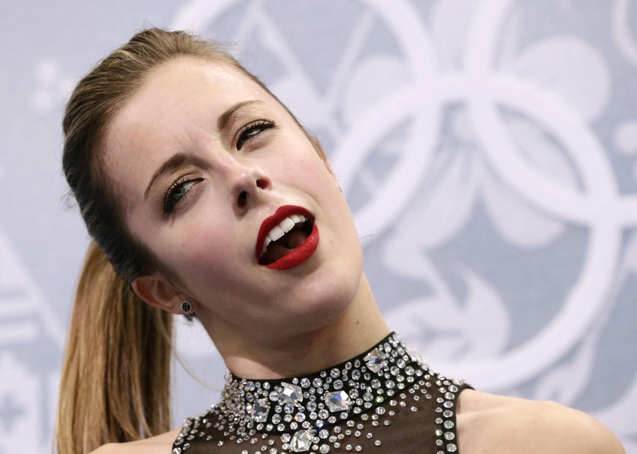 Ashley Wagner of the United States waits in the results area after completing her routine in the women's short program figure skating competition at the Iceberg Skating Palace during the 2014 Winter Olympics, Wednesday, Feb. 19, 2014, in Sochi, Russia. (AP Photo/Bernat Armangue)