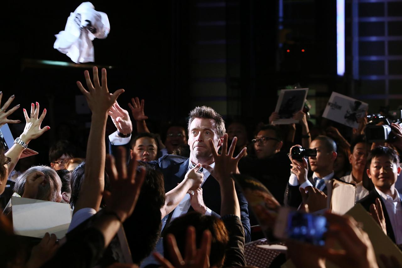 TOKYO, JAPAN - AUGUST 28: Actor Hugh Jackman greets fans as he attends the Japan premiere of 'The Wolverine' at Roppongi Hills on August 28, 2013 in Tokyo, Japan. (Photo by Ken Ishii/Getty Images)