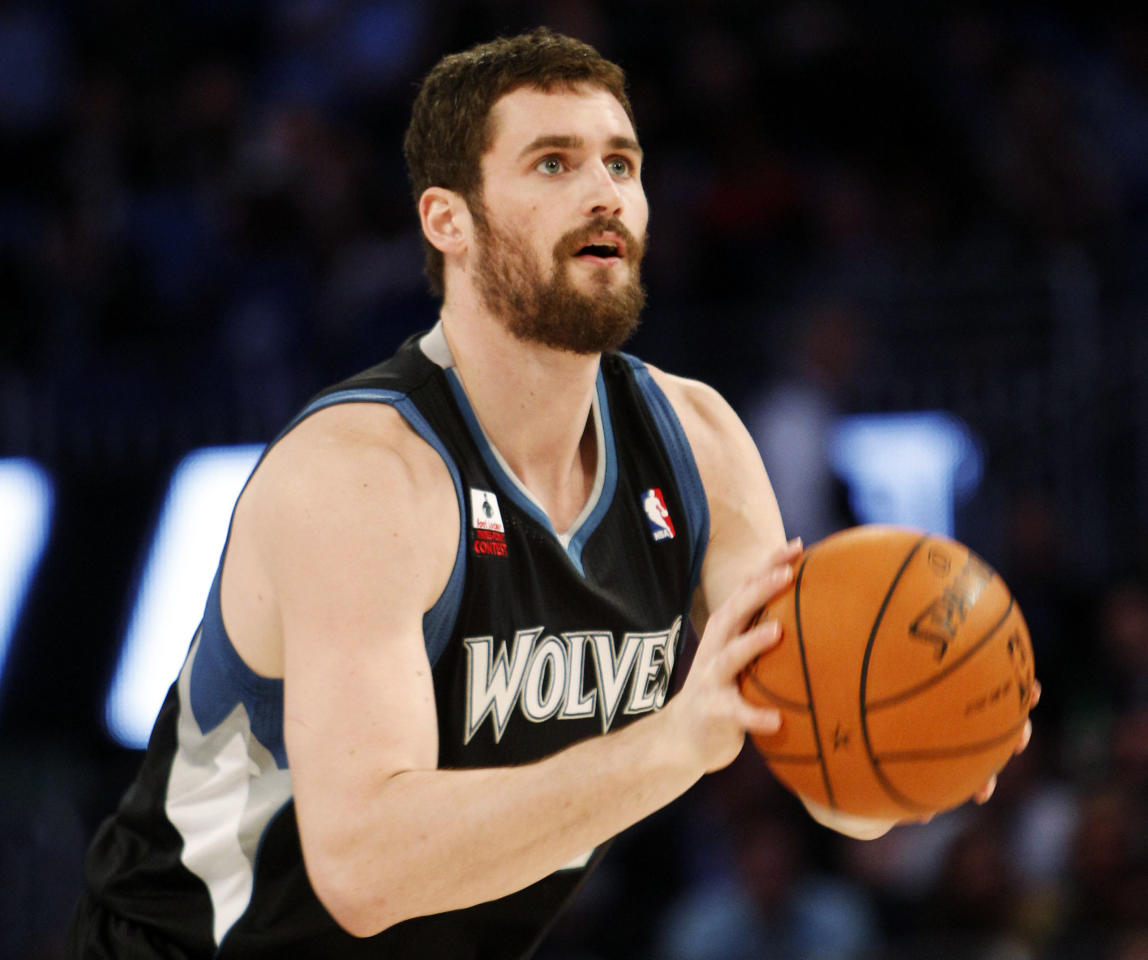 Minnesota Timberwolves' Kevin Love shoots during the NBA All-Star Three-Point Shootout basketball competition in Orlando, Fla., Saturday, Feb. 25, 2012. (AP Photo/Lynne Sladky)