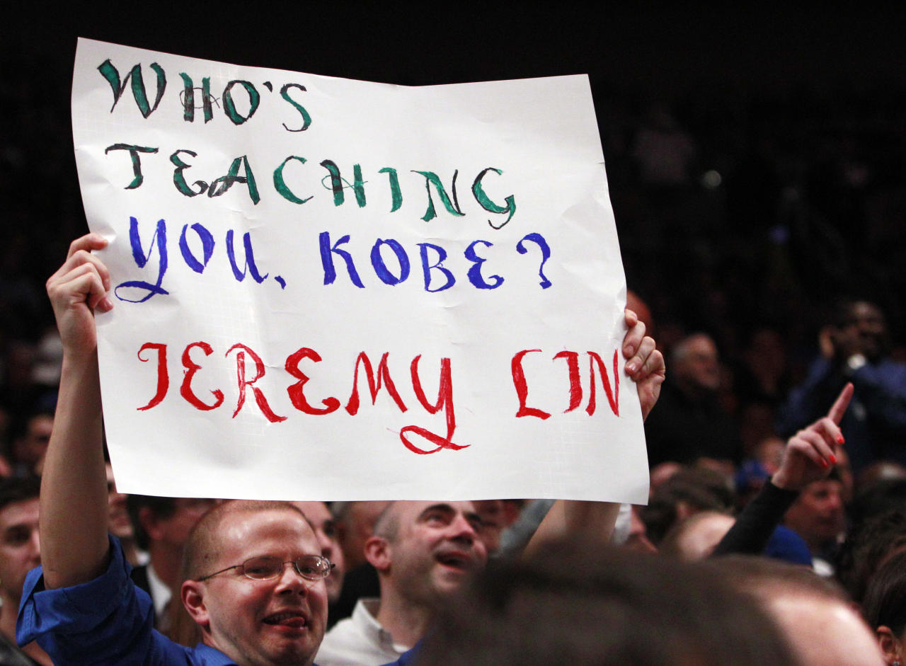 A New York Knicks fan holds up a sign during the second half of an NBA basketball game against the Sacramento Kings, Wednesday, Feb. 15, 2012, in New York. (AP Photo/Frank Franklin II)