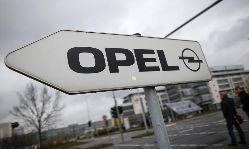 A sign depicting the Opel logo is pictured in front of the Opel Adam AG headquarters in Ruesselheim
