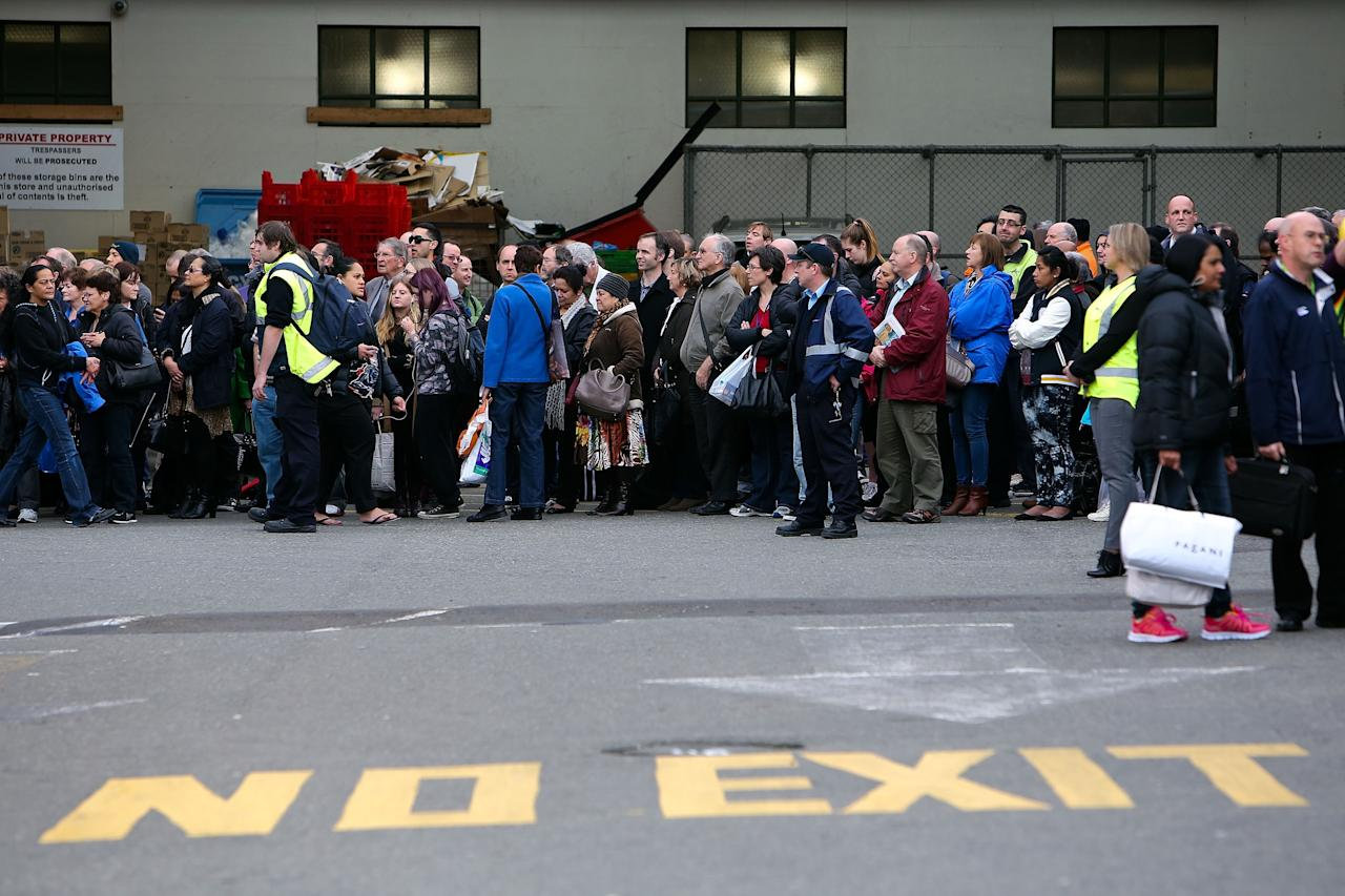 WELLINGTON, NEW ZEALAND - AUGUST 16: Commuters wait for alternative transport after all train services were cancelled following a magnitude 6.2 earthquake on August 16, 2013 in Wellington, New Zealand. The quake struck Wellington at 2:31pm local time and was felt as far as Auckland on the north Island and Dunedin on the south. There have been reports of injuries but no fatalities. (Photo by Hagen Hopkins/Getty Images)