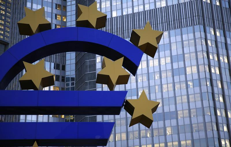 The euro sculpture is seen outside the headquarters of the European Central Bank in Frankfurt