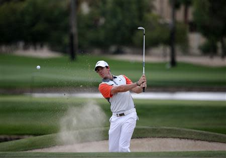 Rory McIlroy of Northern Ireland hits the ball out of the bunker on the 13th hole during the final round of the 2014 Omega Dubai Desert Classic in Dubai
