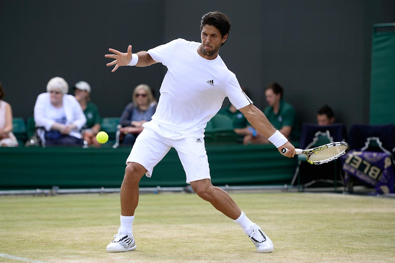 LONDON, ENGLAND - JULY 01: Fernando Verdasco of Spain plays a forehand during the Gentlemen's Singles fourth round match against Kenny de Schepper of France on day seven of the Wimbledon Lawn Tennis Championships at the All England Lawn Tennis and Croquet Club on July 1, 2013 in London, England. (Photo by Dennis Grombkowski/Getty Images)