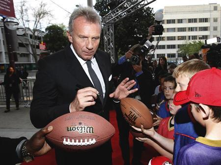 Joe Montana signs autographs as he arrives at the 7th Annual California Hall of Fame induction ceremony at The California Museum in Sacramento