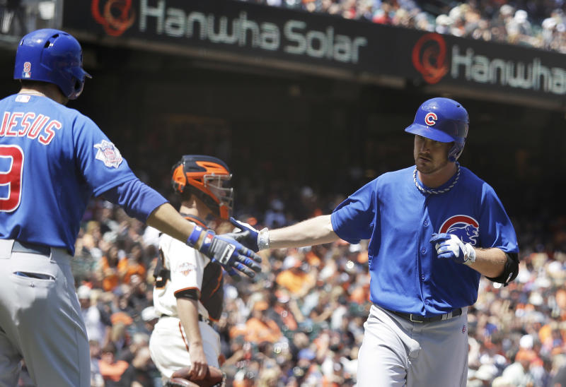 Wood pitches, hits Cubs to 2-1 victory over Giants