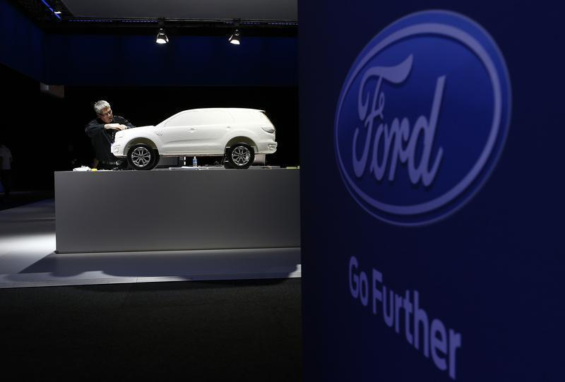 Ford employee works on a model at a media event to launch a concept car in Sydney