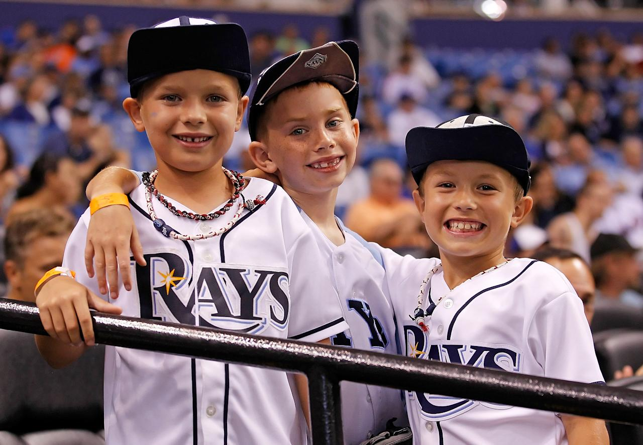 ST. PETERSBURG - JUNE 13:  Fans of the Tampa Bay Rays have their rally caps on in the ninth inning againstof the New York Mets at Tropicana Field on June 13, 2012 in St. Petersburg, Florida.  (Photo by J. Meric/Getty Images)