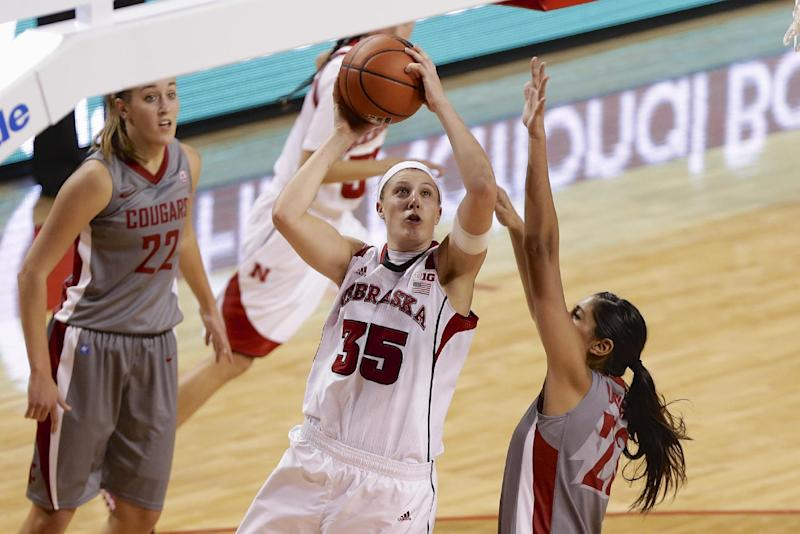 Cougars hit 12 3s in 76-72 upset of No. 10 Huskers