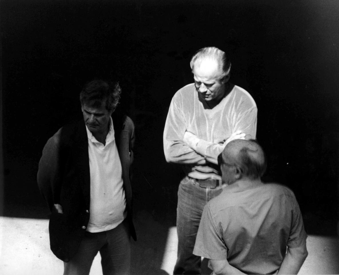 "This 1980 black and white surveillance photo released by the U.S. Attorney's Office and presented as evidence during the first day of a trial for James ""Whitey"" Bulger in U.S. District Court in Boston, Wednesday, June 12, 2013, shows Bulger, center, with Ted Berenson, left, and Phil Wagenheim at a Lancaster Street garage in Boston's North End. Bulger is on trial for a long list of crimes, including extortion and playing a role in 19 killings. (AP Photo/U.S. Attorney's Office)"