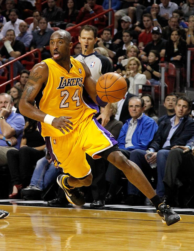 MIAMI, FL - JANUARY 19: Kobe Bryant #24 of the Los Angeles Lakers drives during a game against the Miami Heat at American Airlines Arena on January 19, 2012 in Miami, Florida. NOTE TO USER: User expressly acknowledges and agrees that, by downloading and/or using this Photograph, User is consenting to the terms and conditions of the Getty Images License Agreement.  (Photo by Mike Ehrmann/Getty Images)