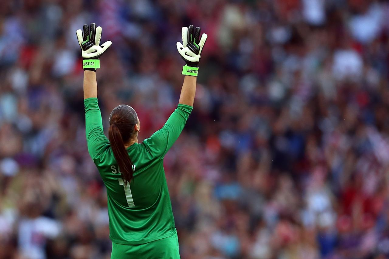 LONDON, ENGLAND - AUGUST 09:  Goalkeeper Hope Solo #1 of United States reacts after Carli Lloyd #10 of United States scores a goal in the first half against Japan during the Women's Football gold medal match on Day 13 of the London 2012 Olympic Games at Wembley Stadium on August 9, 2012 in London, England.  (Photo by Julian Finney/Getty Images)