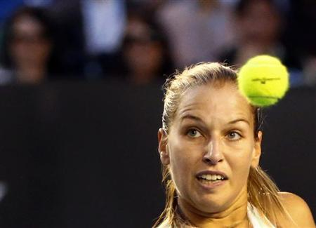 Dominika Cibulkova of Slovakia watches the ball as she hits a return to Li Na of China during their women's singles final match at the Australian Open 2014 tennis tournament in Melbourne
