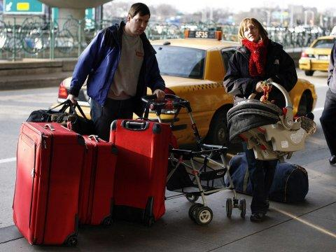 airport laguardia bags vacation baby couple