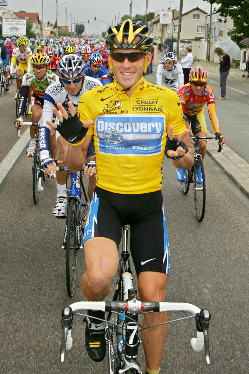 FILE - In this July 24, 2005, file photo, overall leader Lance Armstrong signals seven for his seventh straight win in the Tour de France cycling race as he pedals during the 21st and final stage of the race between Corbeil-Essonnes, south of Paris, and the French capital. The superstar cyclist, whose stirring victories after his comeback from cancer helped him transcend sports, chose not to pursue arbitration in the drug case brought against him by the U.S. Anti-Doping Agency. That was his last option in his bitter fight with USADA and his decision set the stage for the titles to be stripped and his name to be all but wiped from the record books of the sport he once ruled.   (AP Photo/Peter Dejong, File)