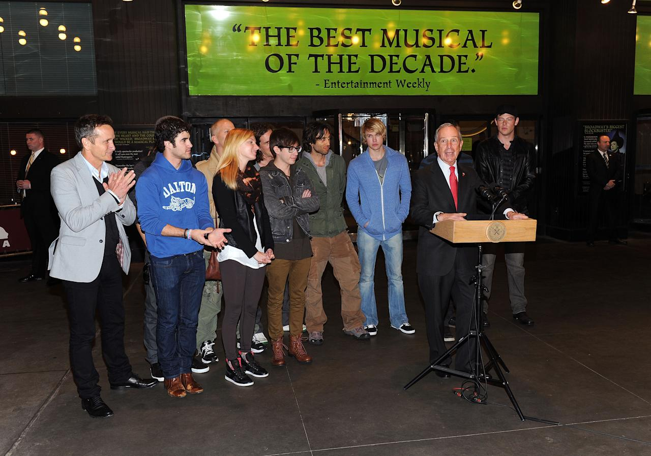 """NEW YORK, NY - APRIL 25:  (L-R)  Dante Di Loreto, Darren Criss, Harry Shum Jr., Ryan Murphy, Heather Morris, Kevin McHale, Ian Brennan, Brad Falchuk. Chord Overstreet, Mark Salling and Cory Monteith of Glee pose with Mayor of New York City, Michael Bloomberg during the """"Glee"""" In New York Press Conference at Gershwin Theatre on April 25, 2011 in New York City.  (Photo by Jason Kempin/Getty Images)"""