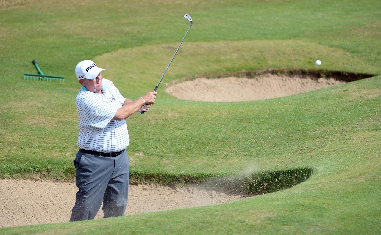 SOUTHPORT, ENGLAND - JULY 25: Mark Calcavecchia of the USA during the first round of The Senior Open Championship at Royal Birkdale on July 25, 2013 in Southport, England. (Photo by Ross Kinnaird/Getty Images)