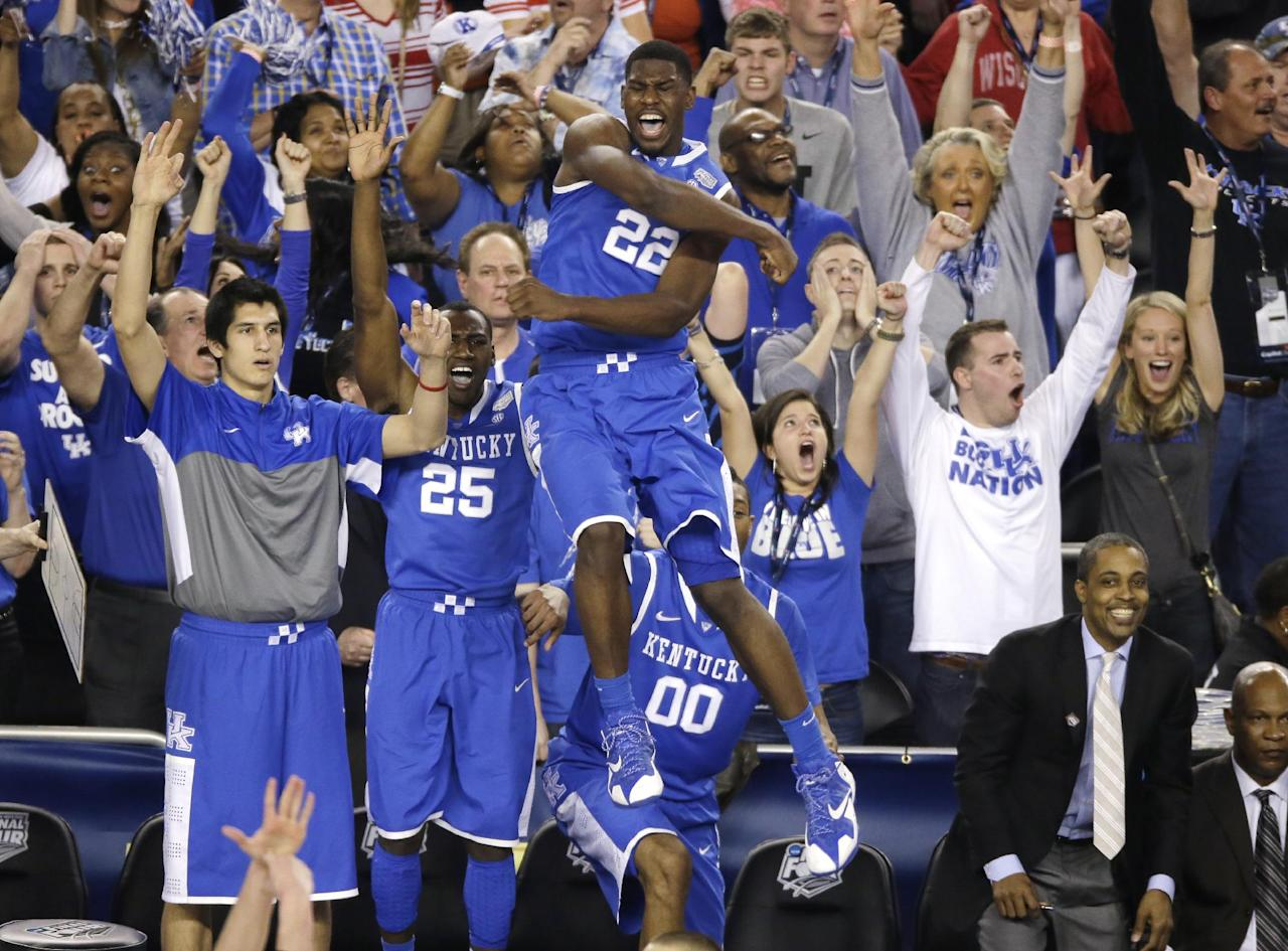 Kentucky forward Alex Poythress (22) reacts after a three-point basket during the second half of an NCAA Final Four tournament college basketball semifinal game against Wisconsin Saturday, April 5, 2014, in Arlington, Texas. Kentucky won 74-73. (AP Photo/Tony Gutierrez)