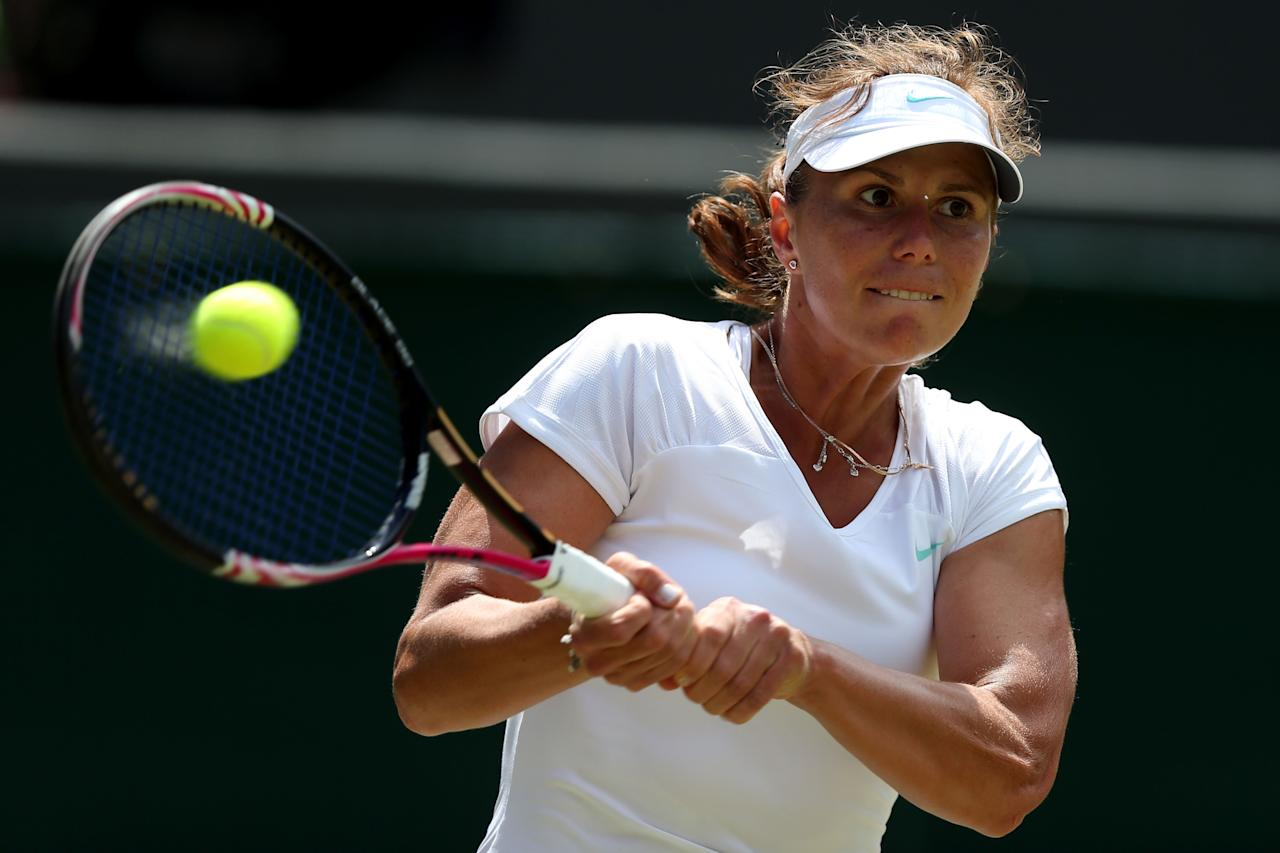 LONDON, ENGLAND - JUNE 30:  Varvara Lepchenko of the USA in action during her Ladies' Singles third round match against Petra Kvitova of the Czech Republic  on day six of the Wimbledon Lawn Tennis Championships at the All England Lawn Tennis and Croquet Club at Wimbledon on June 30, 2012 in London, England.   (Photo by Clive Rose/Getty Images)