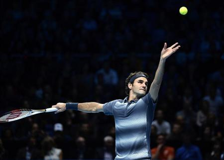 Roger Federer of Switzerland serves to Rafael Nadal of Spain during their men's singles semi-final tennis match at the ATP World Tour Finals at the O2 Arena in London