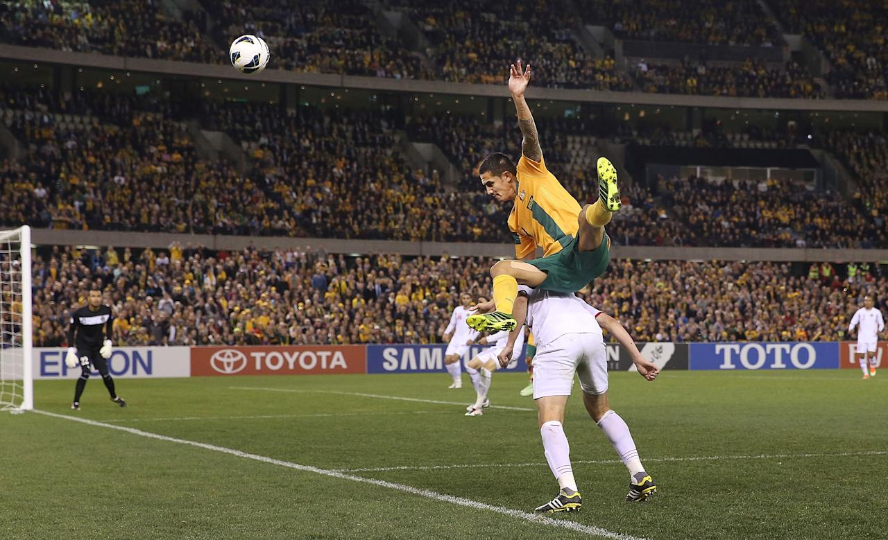MELBOURNE, AUSTRALIA - JUNE 11:  and Tim Cahill of the Socceroos jumps on Anas Bani Yaseen (R) of Jordan during the FIFA World Cup Qualifier match between the Australian Socceroos and Jordan at Etihad Stadium on June 11, 2013 in Melbourne, Australia.  (Photo by Michael Dodge/Getty Images)
