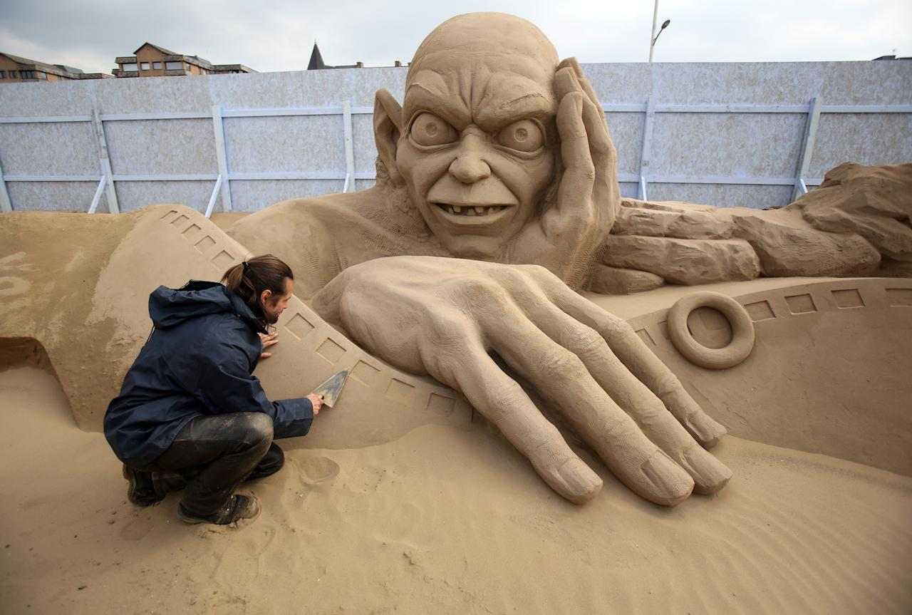 WESTON-SUPER-MARE, ENGLAND - MARCH 26:  Sand sculptor Radavan Zivny works on a sand sculpture of Gollum as pieces are prepared as part of this year's Hollywood themed annual Weston-super-Mare Sand Sculpture festival on March 26, 2013 in Weston-Super-Mare, England. Due to open on Good Friday, currently twenty award winning sand sculptors from across the globe are working to create sand sculptures including Harry Potter, Marilyn Monroe and characters from the Star Wars films as part of the town's very own movie themed festival on the beach.  (Photo by Matt Cardy/Getty Images)