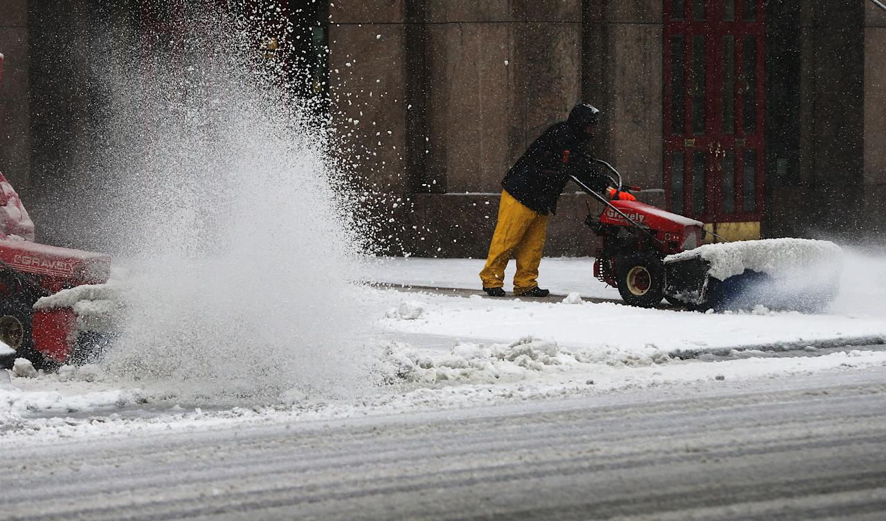 BOSTON, MA - FEBRUARY 08:  People clear a sidewalk with snowblowers on February 8, 2013 in Boston, Massachusetts. Massachusetts and other states from New York to Maine are preparing for a major blizzard with possible record amounts of snowfall in some areas.  (Photo by Mario Tama/Getty Images)