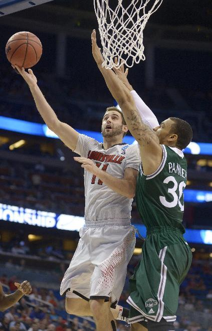 Louisville comes alive late, beats Manhattan 71-64