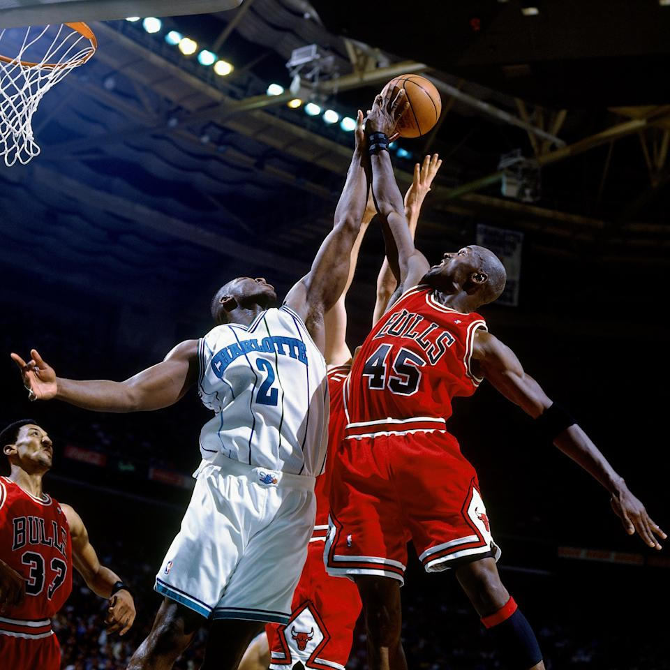 CHARLOTTE, NC - APRIL 30:  Larry Johnson #2 of the Charlotte Hornets battles for a rebound against Michael Jordan #45 of the Chicago Bulls in Game Two of the Eastern Conference Quarterfinals during the 1995 NBA Playoffs at the Charlotte Coliseum on April 30, 1995 in Charlotte, North Carolina.  The Charlotte Hornets defeated the Chicago Bulls 106-89. NOTE TO USER: User expressly acknowledges and agrees that, by downloading and or using this photograph, User is consenting to the terms and conditions of the Getty Images License Agreement. Mandatory Copyright Notice: Copyright 1995 NBAE (Photo by Nathaniel S. Butler/NBAE via Getty Images)