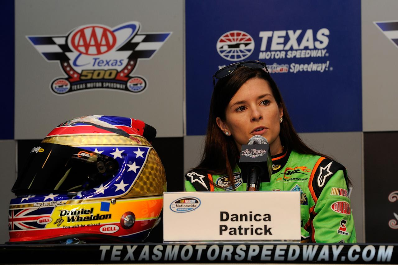 FORT WORTH, TX - NOVEMBER 04:  Danica Patrick, driver of the #7 GoDaddy.com /DanWheldonMemorial.com Chevrolet, speaks at a press conference announcing her donation to the auction benefitting the Dan Wheldon Family Trust Fund following practice for the NASCAR Nationwide Series O'Reilly Auto Parts Challenge at Texas Motor Speedway on November 4, 2011 in Fort Worth, Texas. The helmet design is in memory of IRL driver Dan Wheldon who died in a multiple car wreck while driving in the IZOD IndyCar World Championships at Las Vegas on October 16.  (Photo by John Harrelson/Getty Images for NASCAR)