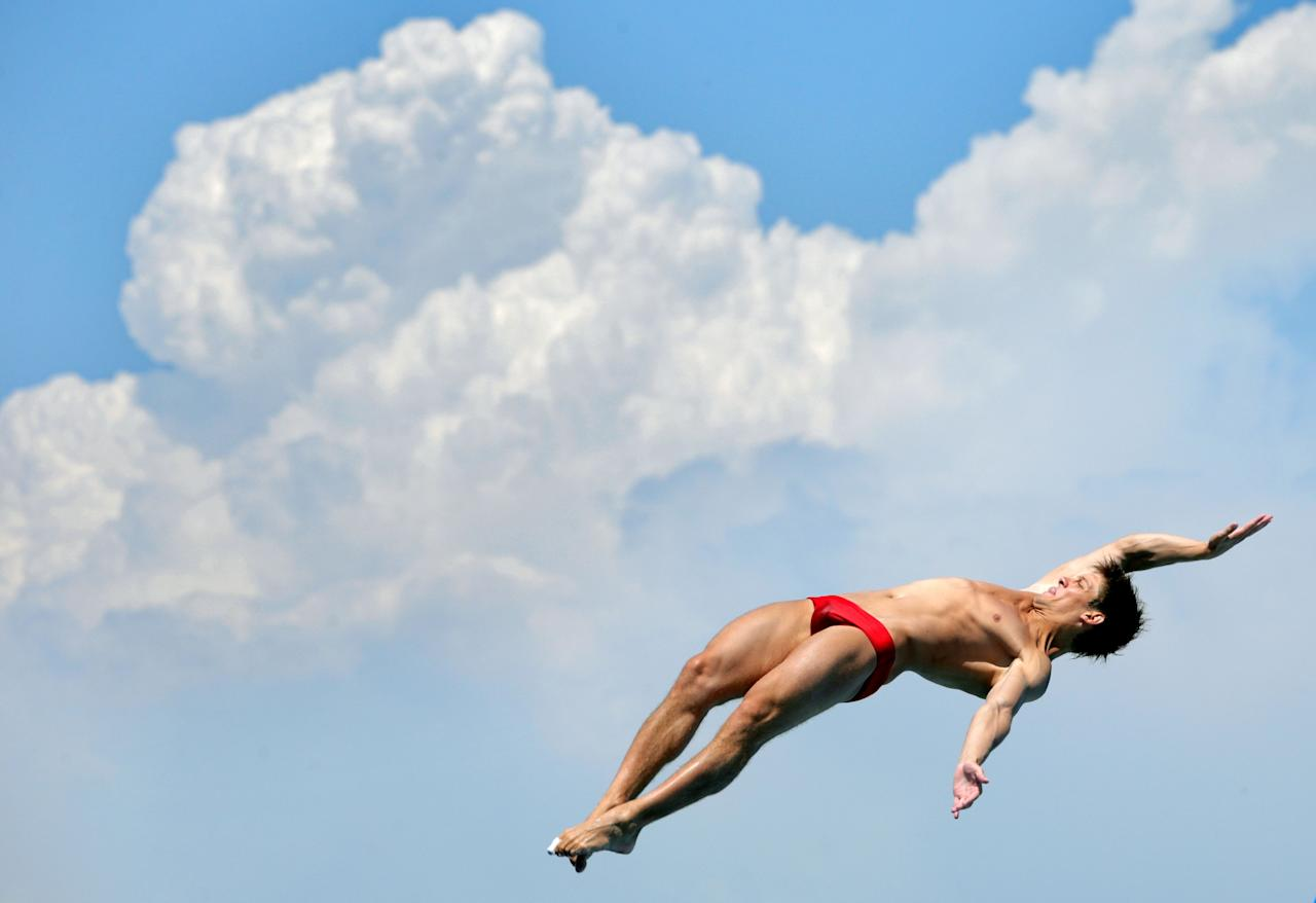 BARCELONA, SPAIN - JULY 22: Illya Kvasha of Ukraine competes in the Men's 1m Springboard Diving final on day three of the 15th FINA World Championships at Piscina Municipal de Montjuic on July 22, 2013 in Barcelona, Spain. (Photo by Adam Pretty/Getty Images)