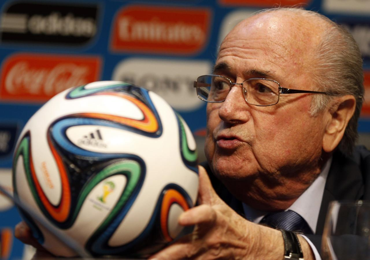 FIFA President Sepp Blatter holds an official 2014 FIFA World Cup soccer ball during a media conference in Sao Paulo June 5, 2014. The 2014 World Cup will be held in 12 cities in Brazil from June 12 to July 13. REUTERS/Paulo Whitaker (BRAZIL - Tags: SPORT SOCCER WORLD CUP)