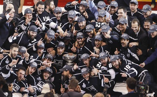 The Los Angeles Kings pose for a photo after beating the New Jersey Devils 6-1 to win the Stanely Cup during Game 6 of the NHL hockey Stanley Cup finals, Monday, June 11, 2012, in Los Angeles. (AP Photo/Jae C. Hong)