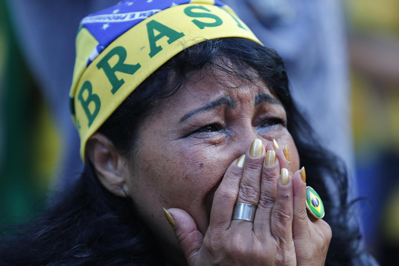 A fan of Brazil reacts as she watches as the Netherlands scores a second goal against Brazil, during the match for the third place finish of the World Cup, at the FIFA Fan Fest in Sao Paulo, Brazil, Saturday, July 12, 2014. (AP Photo/Dario Lopez-Mills)